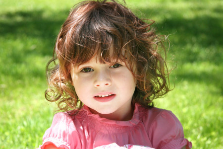 Little Girl Outdoors in the Grass
